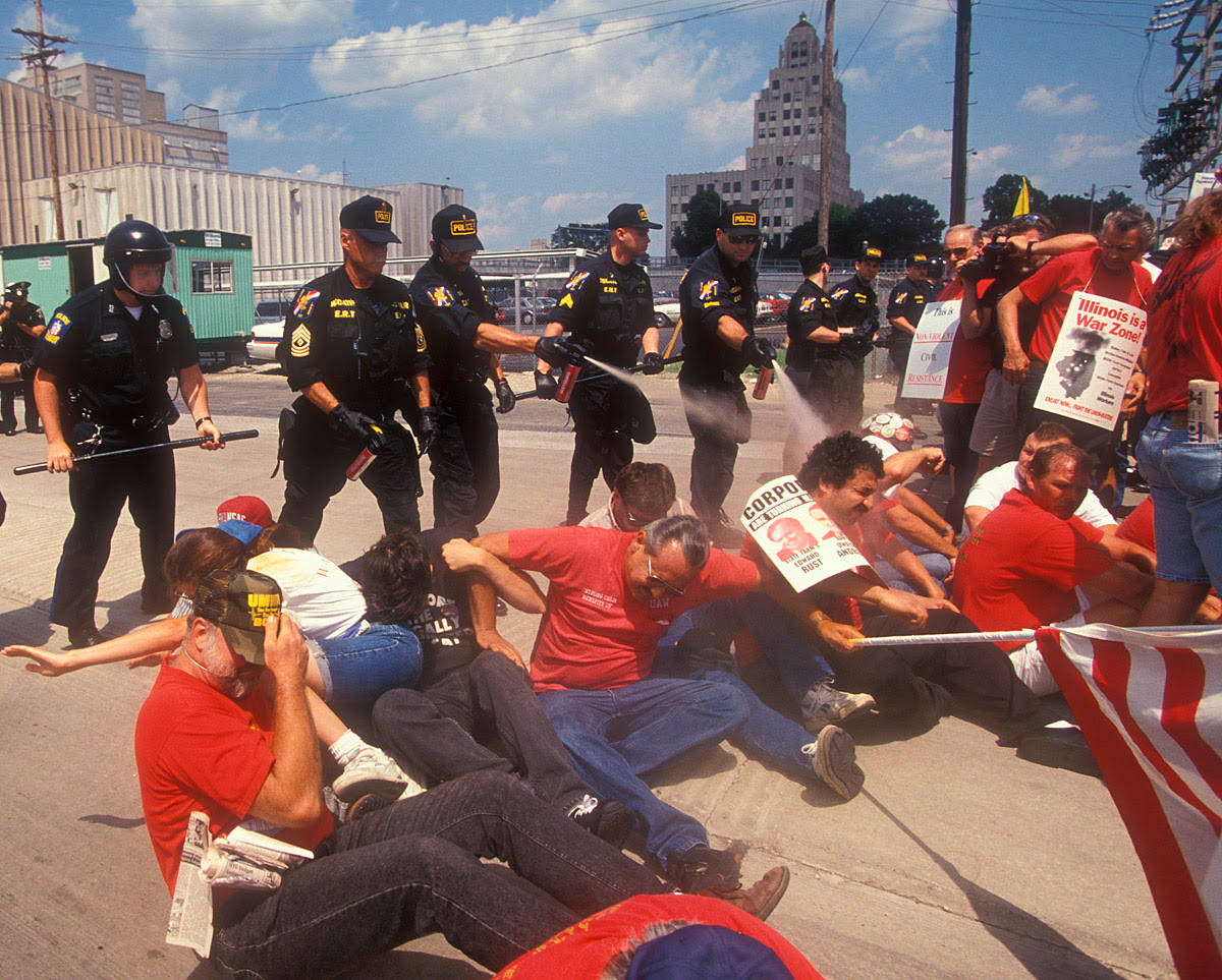 Police use pepper spray on locked-out workers at the A.E. Staley Co. in Decatur, Illinois.