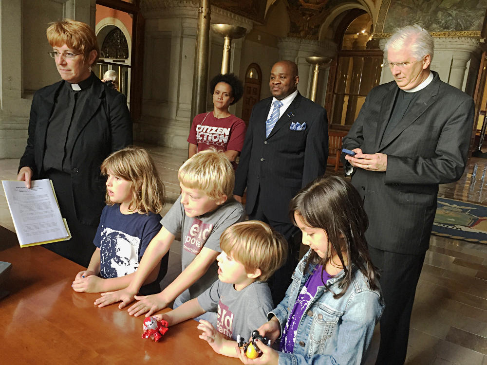 Taking action for a Moral Revival: Children and clergy deliver the Moral Declaration to an office at the Capitol.