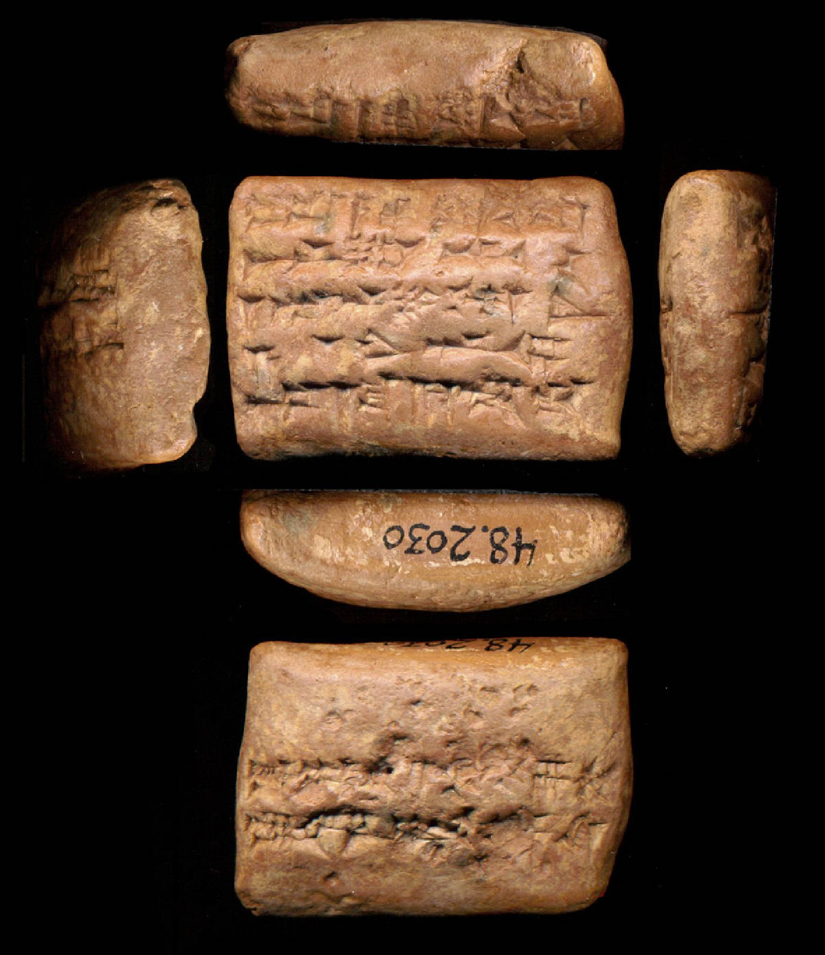 A clay tablet with cuneiform writing