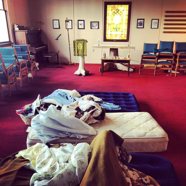 Mattresses and blankets on the floor of the sanctuary in Grays Harbor, WA.