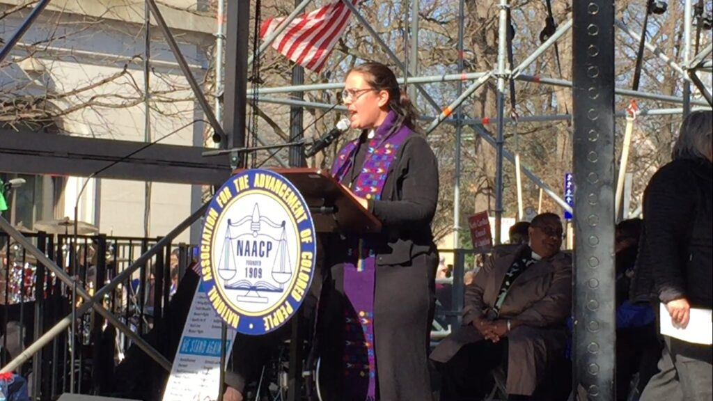 Rev. Dr. Liz Theoharis speaking at the Moral March in Raleigh, NC.